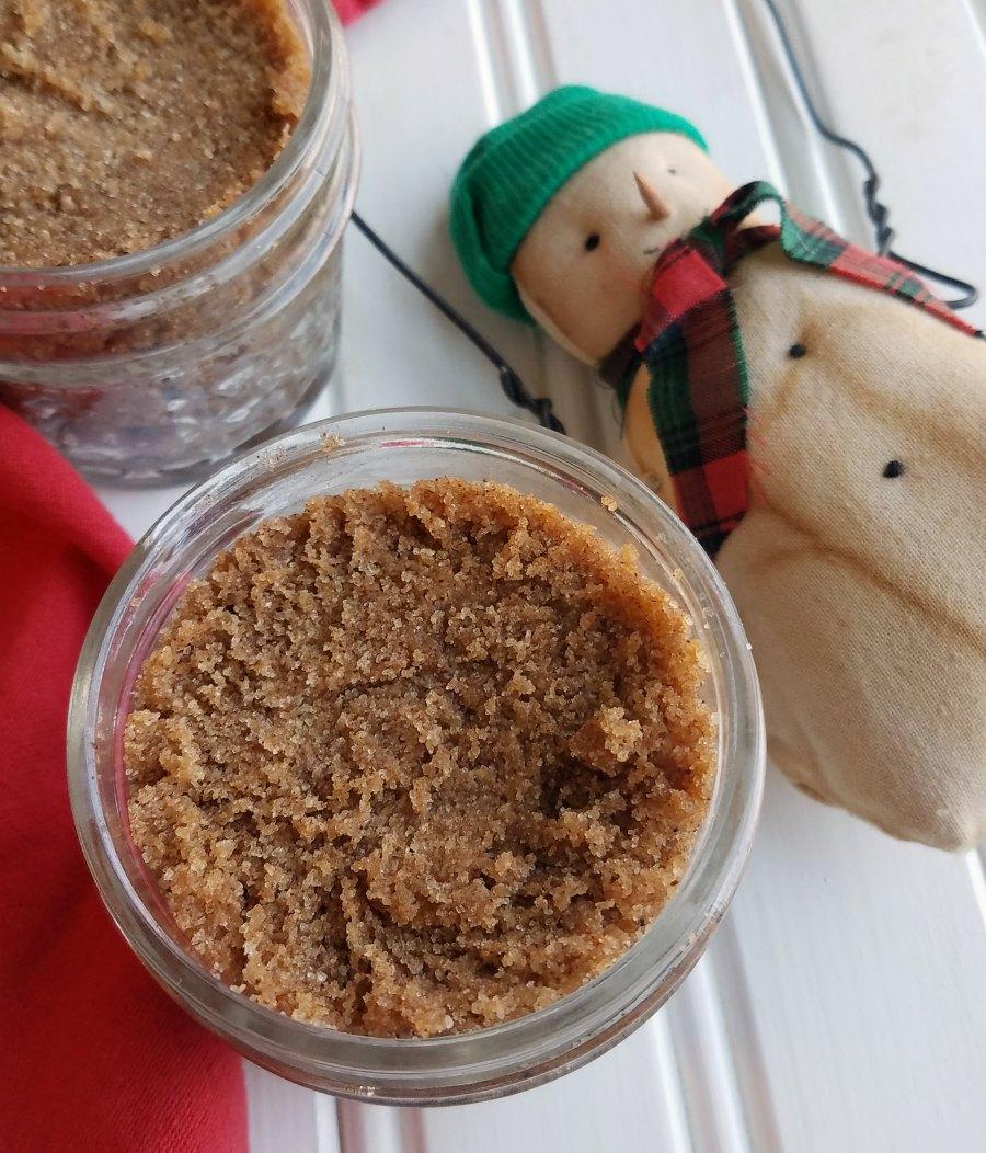 jars of brown sugar scrub next to small snowman