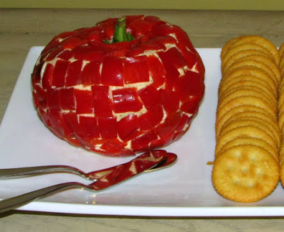 cheese ball shaped like apple coated in red bell pepper
