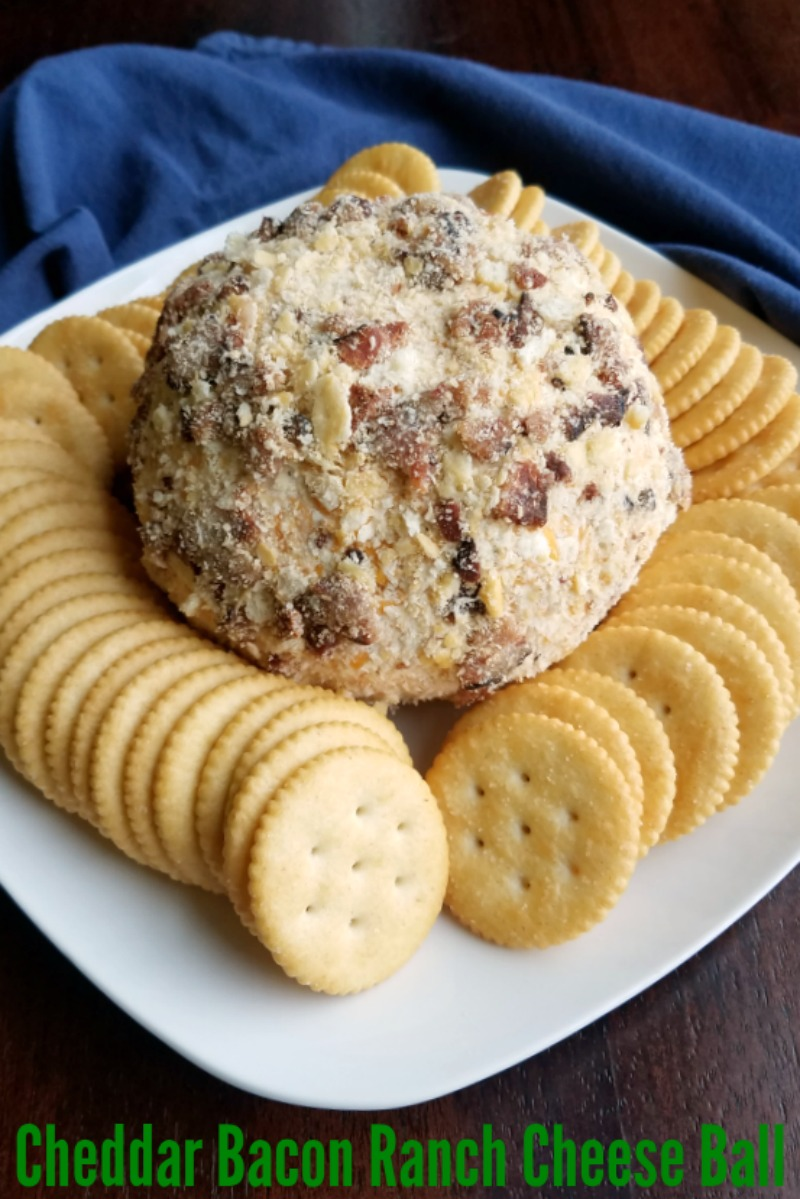 The savory flavors of cheddar, bacon and ranch are the perfect combination for an out of this world cheese ball. It is a perfect appetizer for any party. Cheese balls also transport well, so they are great for tailgating and potlucks too!