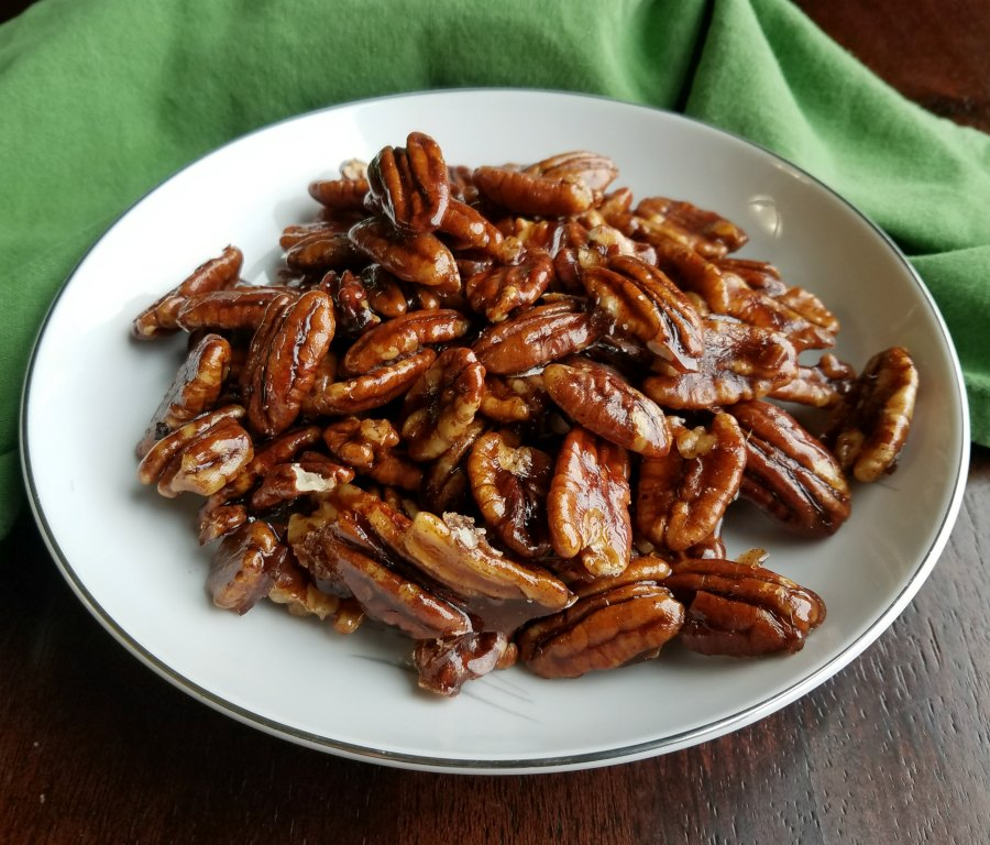 close up of shiny sweet pecans.