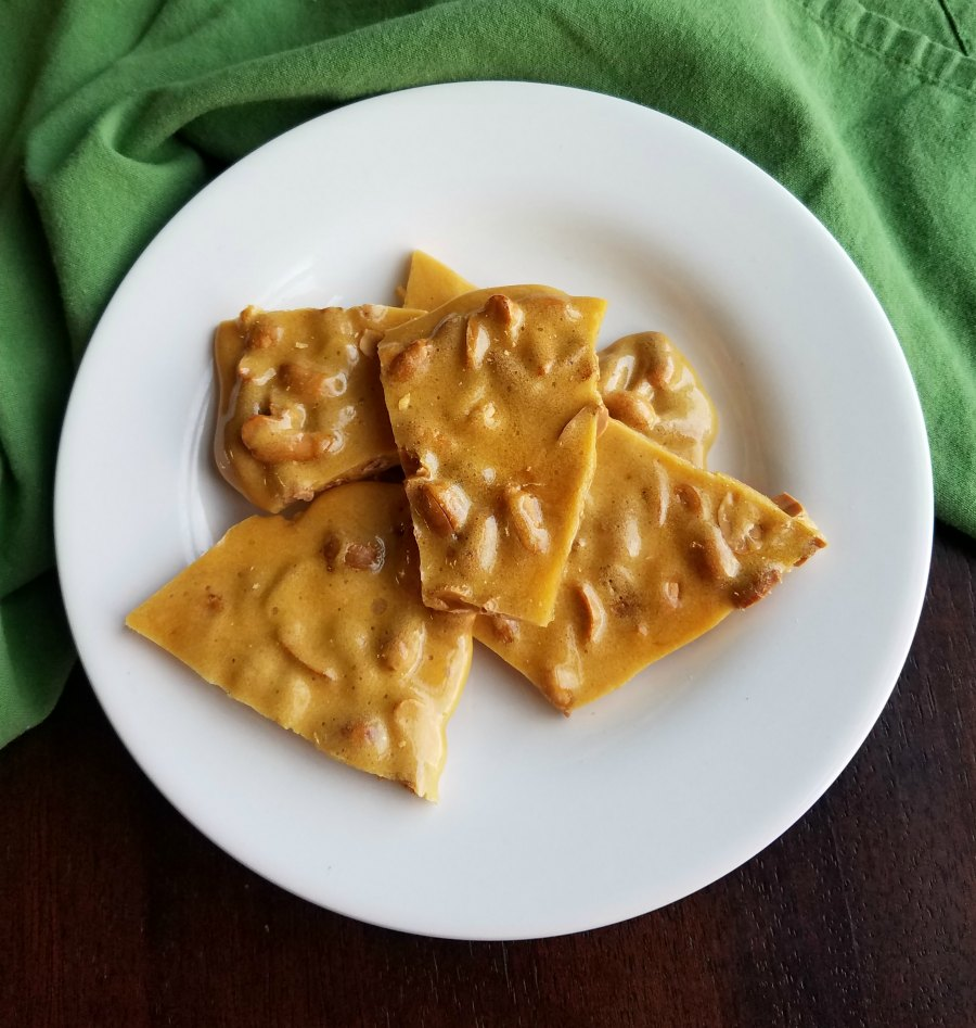 plate of pieces of easy microwave peanut brittle