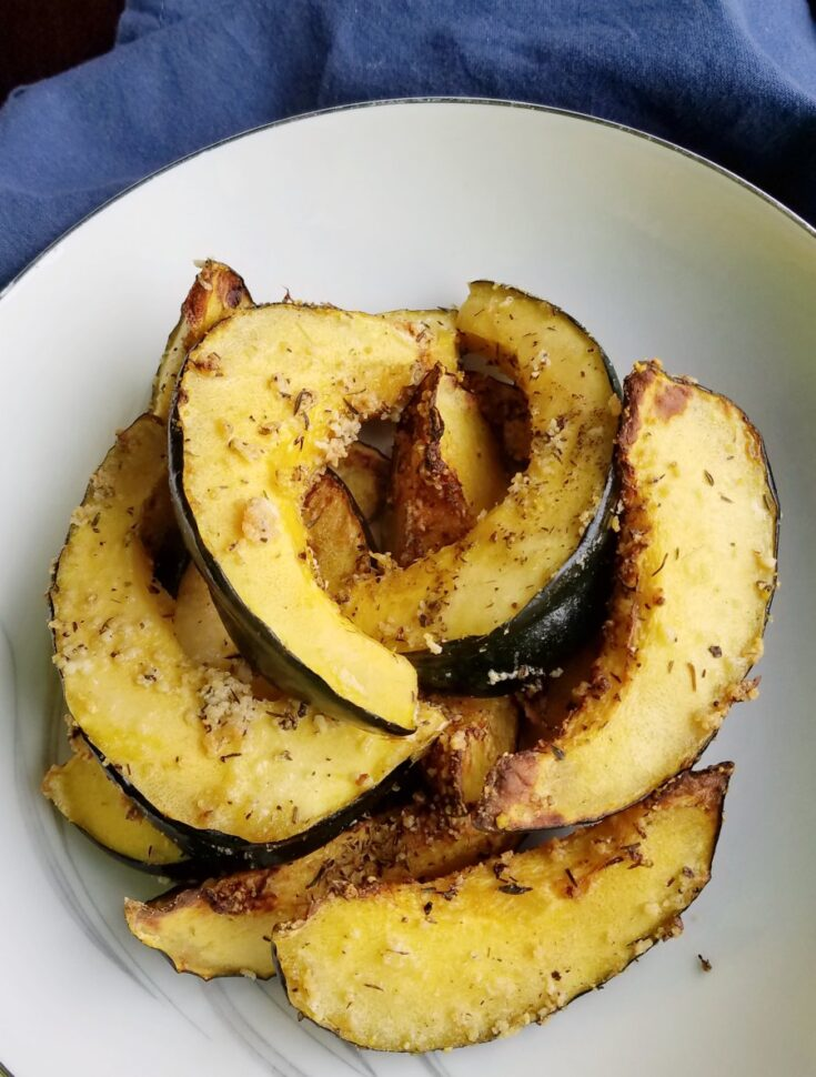 Pile of Parmesan roasted acorn squash ready to eat.