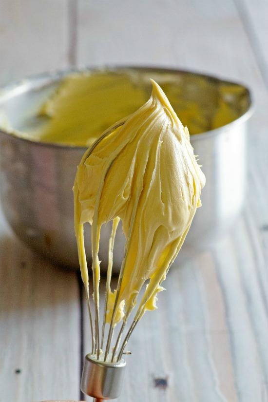 whisk full of maple buttercream