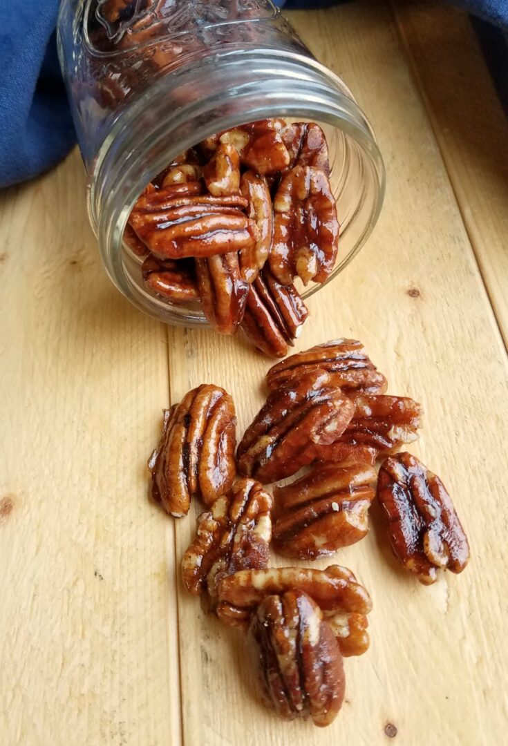 bowl of pecans with crunchy caramel coating.