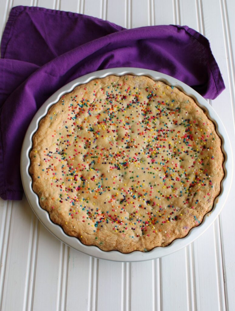 baked cookie with tons of sprinkles on top.