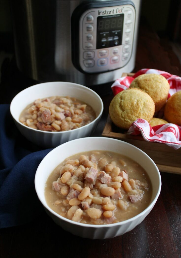 two bowls of ham and beans with corn muffins and instant pot