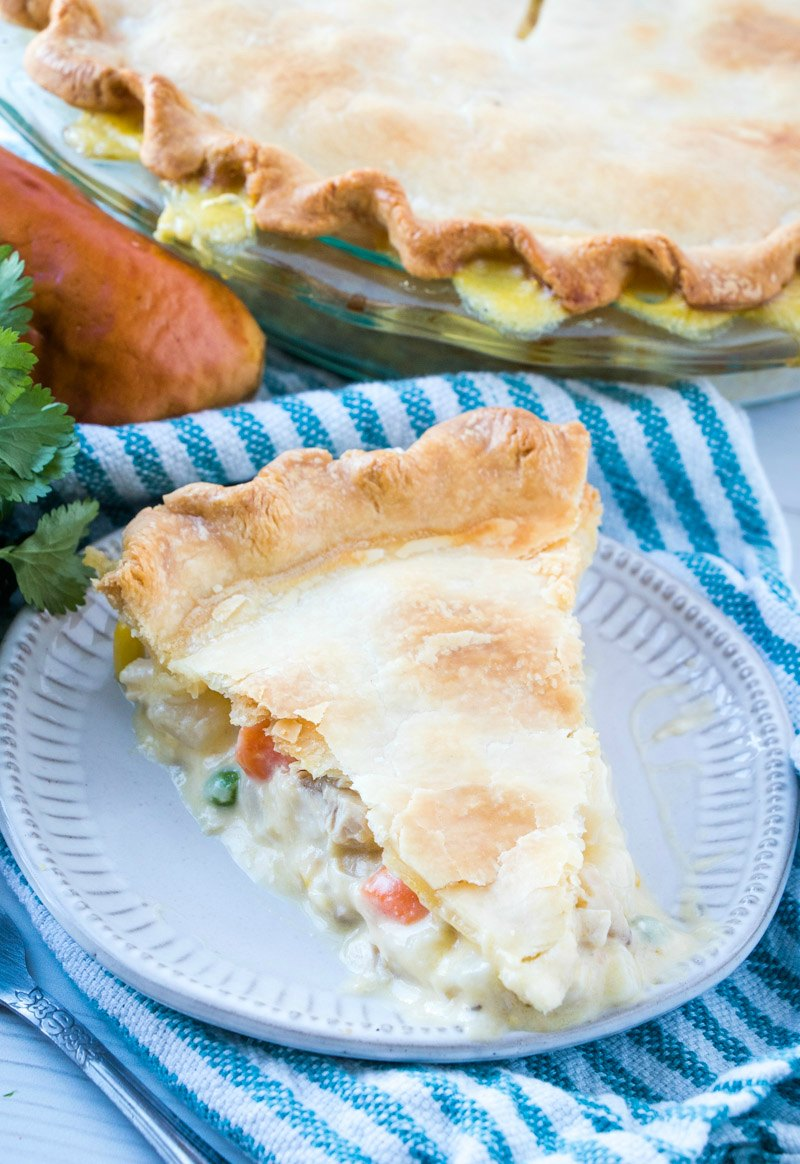 Two layers of flaky pie crust hold a creamy filling loaded with chicken and vegetables. This creamy chicken pot pie is a perfect comfort food meal and is a perfect way to use up some leftover chicken or turkey.