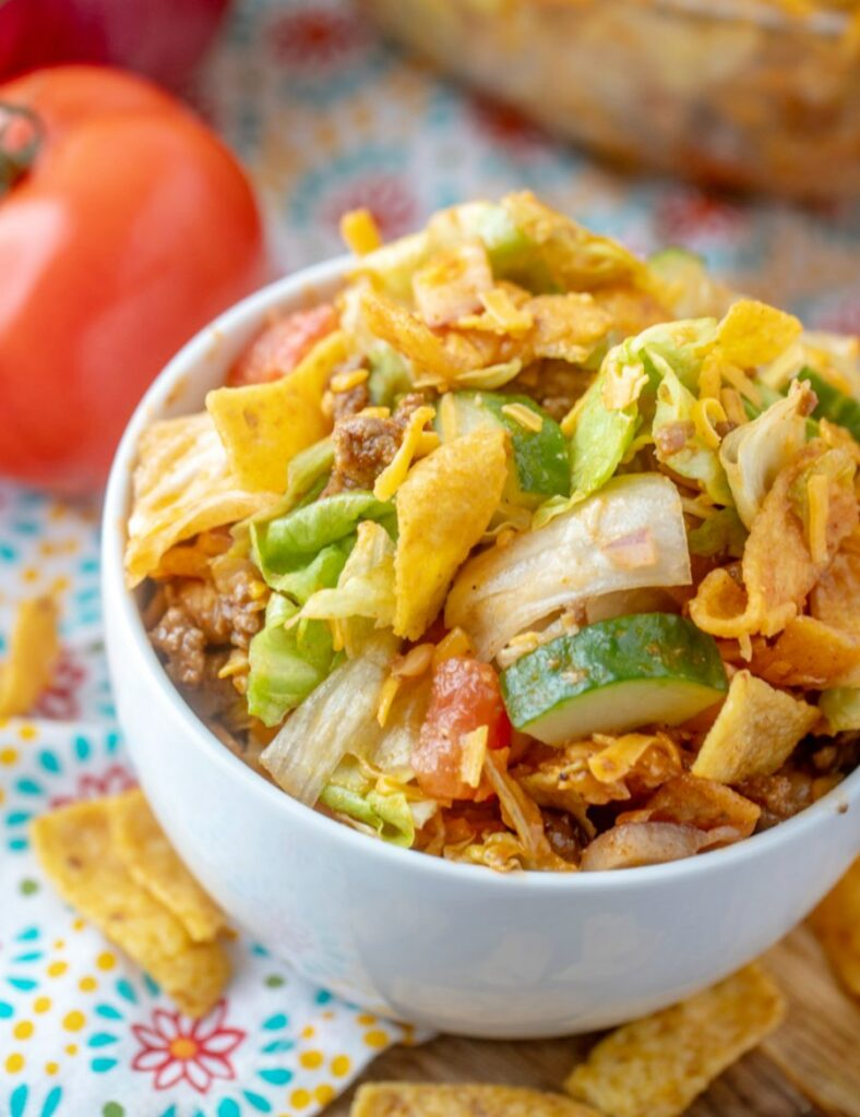 looking down at a bowl of frito taco salad, served and ready to eat.