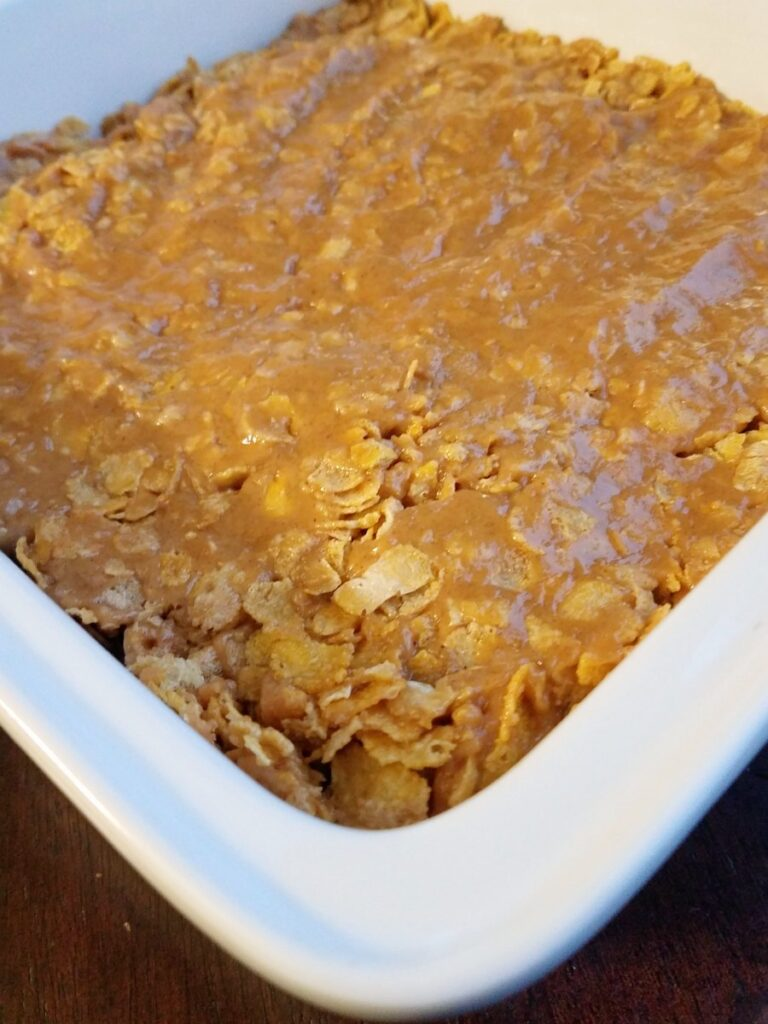 peanut butter corn flake mixture pressed into pan.