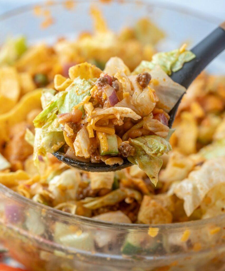 serving spoon full of frito taco salad.