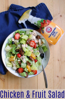 bowl of salad with bottle of arm & hammer fruit and vegetable wash