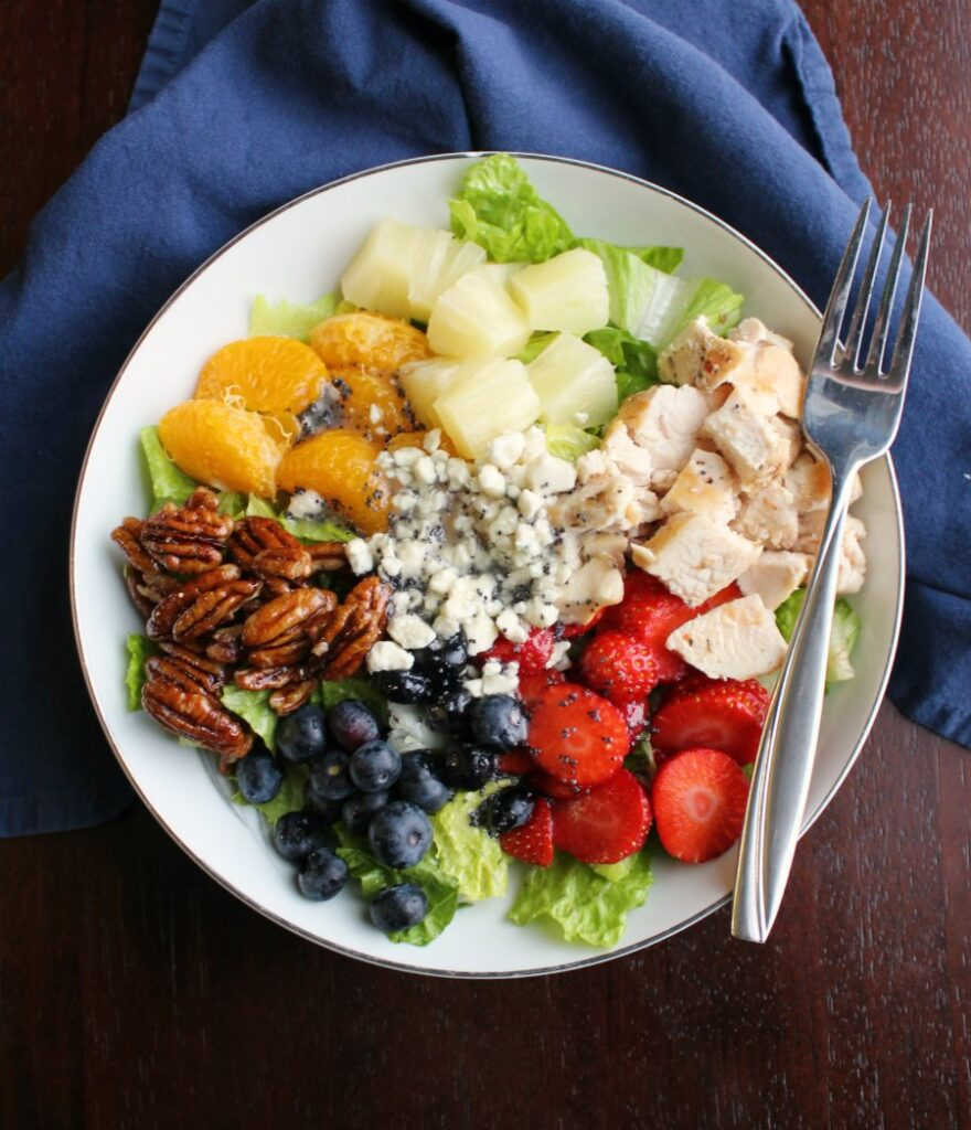 Portillos copycat fruit and chicken salad drizzled with homemade poppy seed dressing.