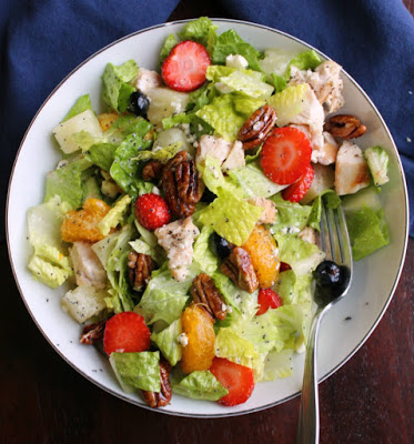 tossed copycat Portillos chicken and fruit poppy seed salad with fork ready to eat