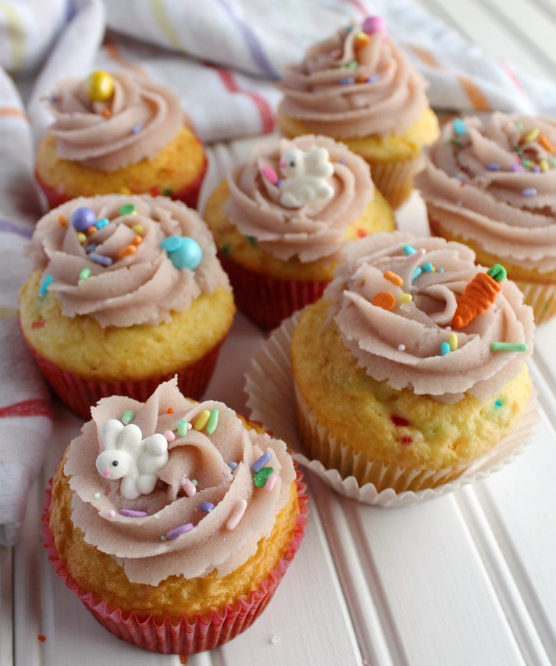 sugar cookie dough frosting swirls on cupcakes with cute bunny and carrot sprinkles.