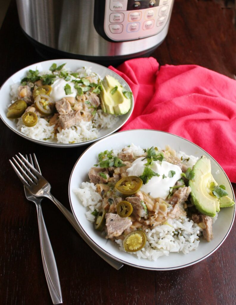 pork burrito bowls with garnishes in front of instant pot.
