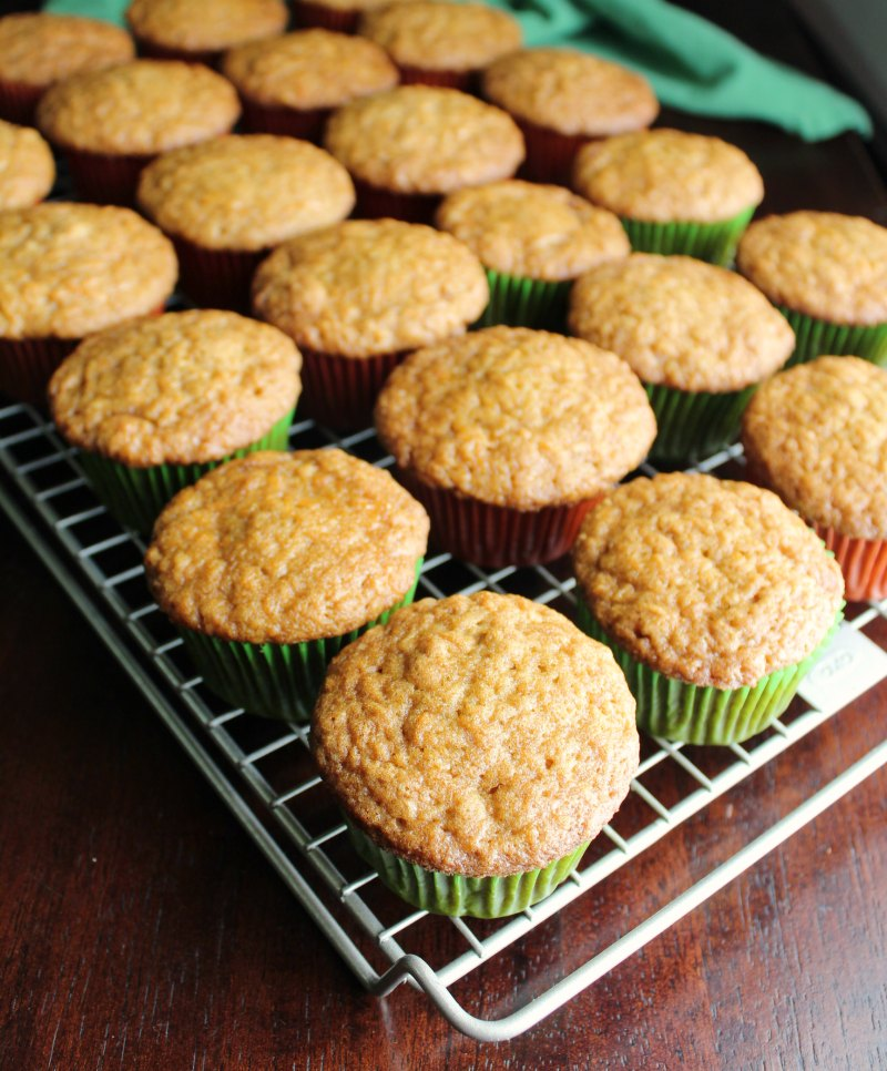 carrot cake cupcakes on wire cooling rack.
