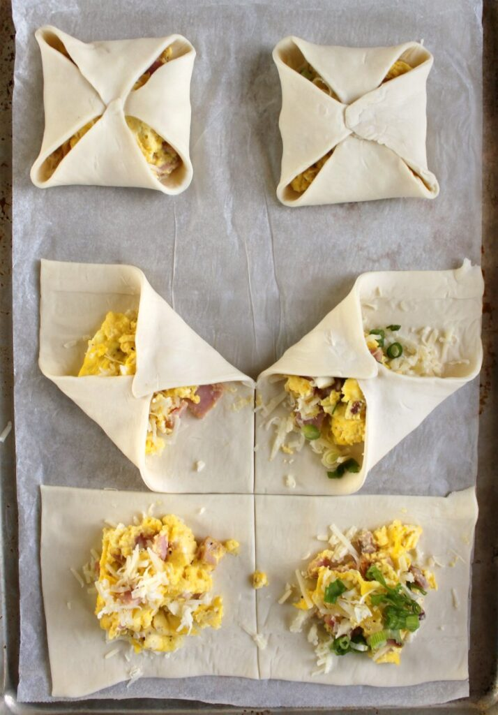 folding puff pastry squares around ham egg and cheese filling to make flaky hand pies.