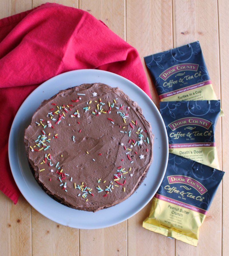 whole frosted chocolate mayo cake with packages of door county coffee.