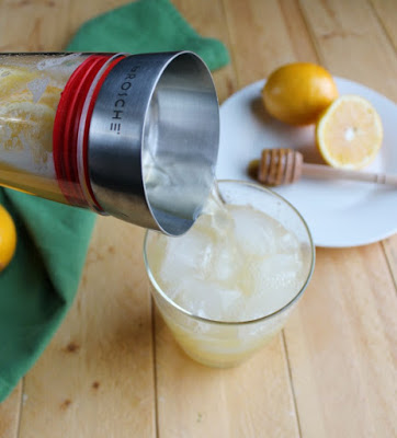 pouring glass of honey lemonade