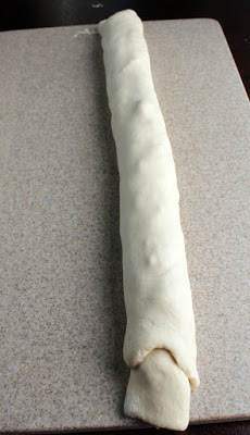 bread dough rolled around cheddar and bacon filling