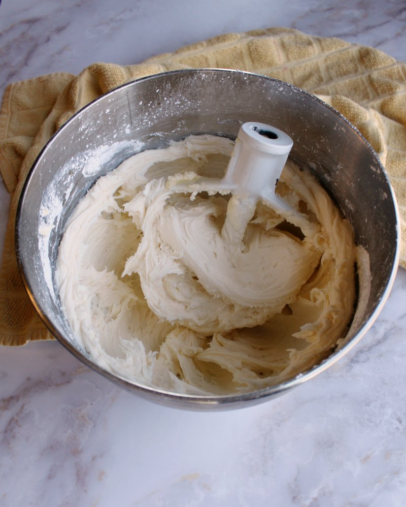 mixer bowl full of honey lemon buttercream frosting.