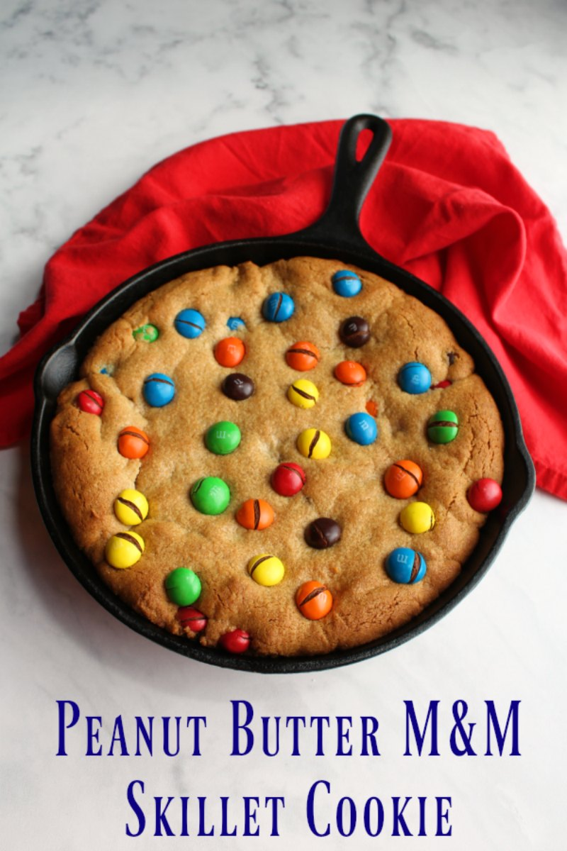 A chewy peanut butter cookie studded with plenty of peanut butter M&M's and baked in a skillet. This peanut butter M&M skillet cookie is just waiting for you to take a slice!