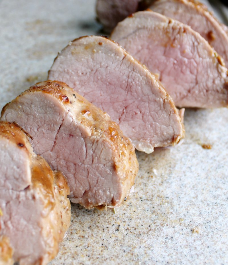 slices of tenderloin with blush of pink in the center, ready to eat.