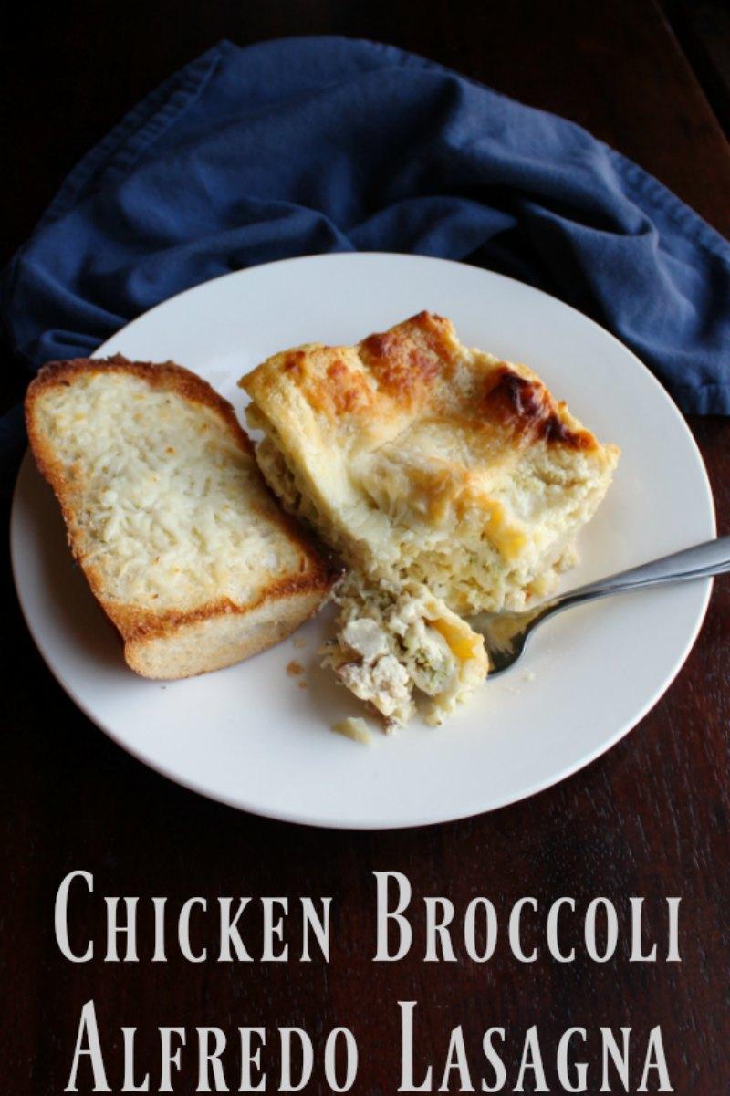 plate of chicken broccoli alfredo lasagna with garlic bread