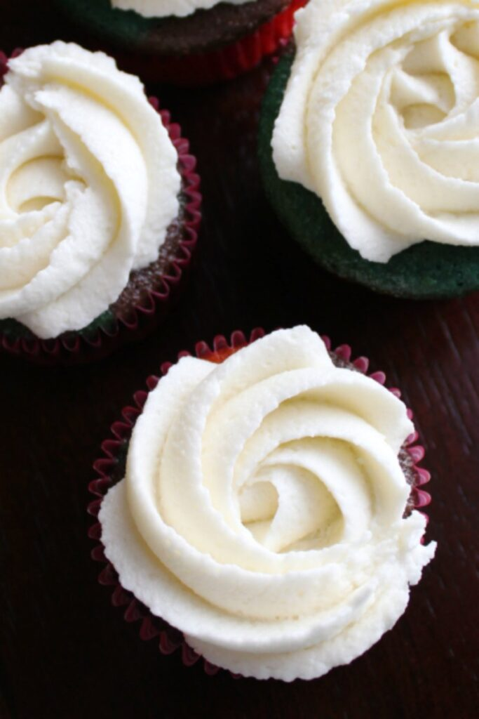 cream cheese frosting rosettes on cupcakes.