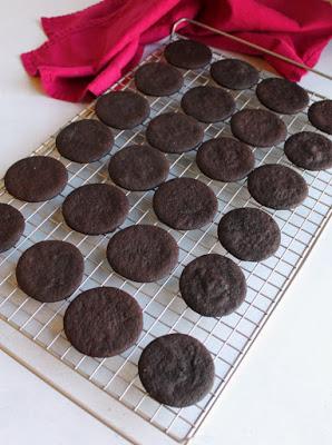 dark chocolate cookie circles on cooling rack