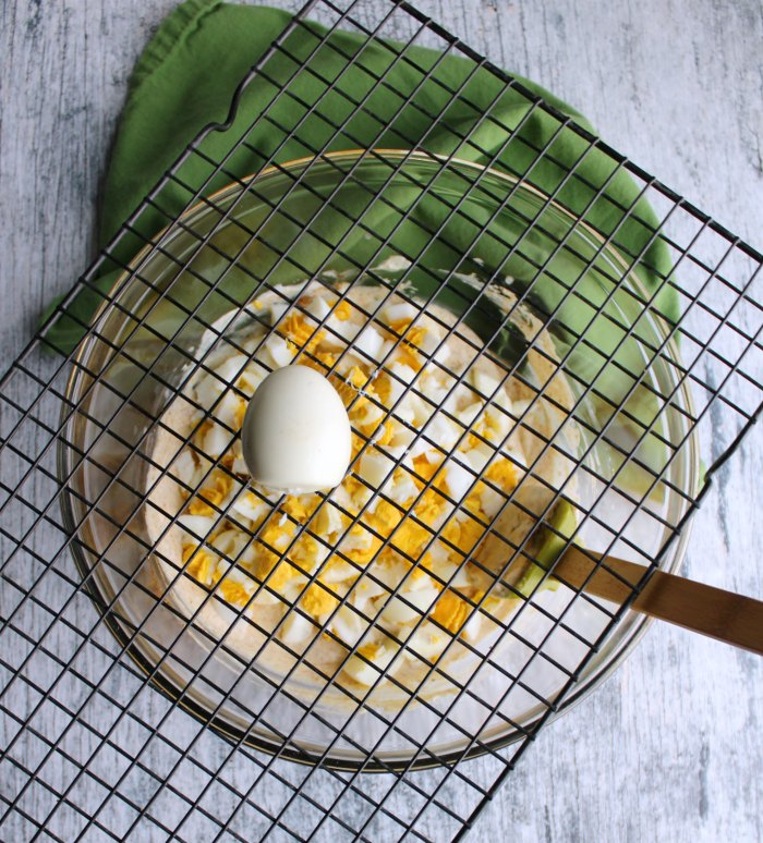 using squares of cooling rack to dice hard boiled eggs for salad.