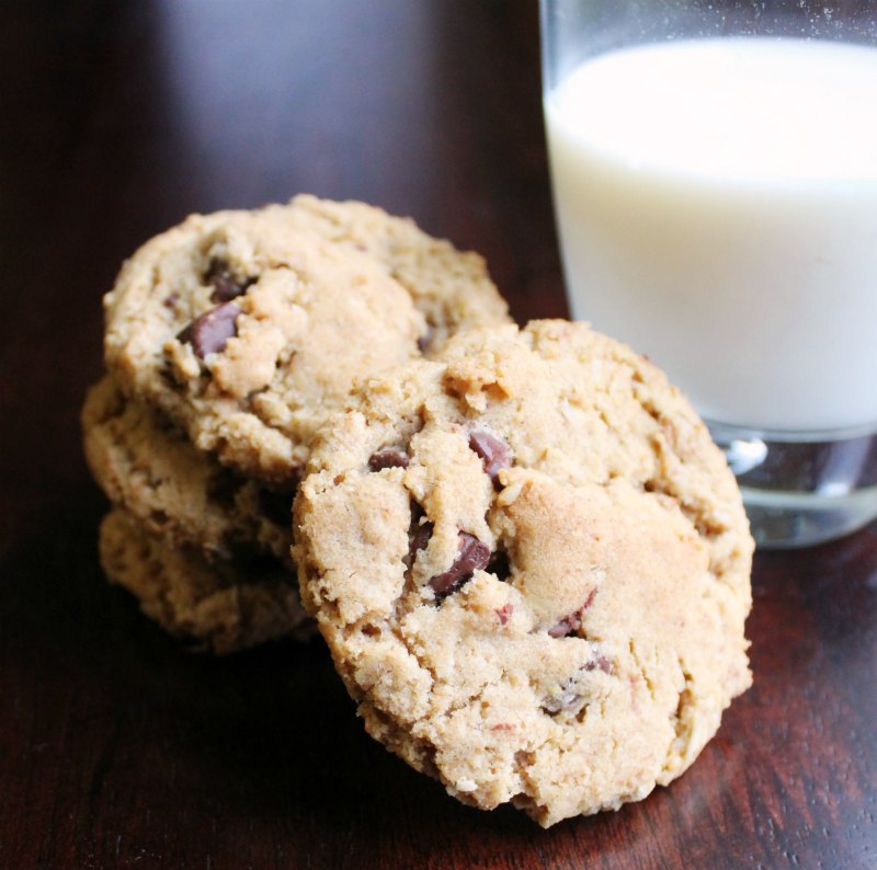 close up of a stack of brown butter cowgirl cookies next to a glass of milk
