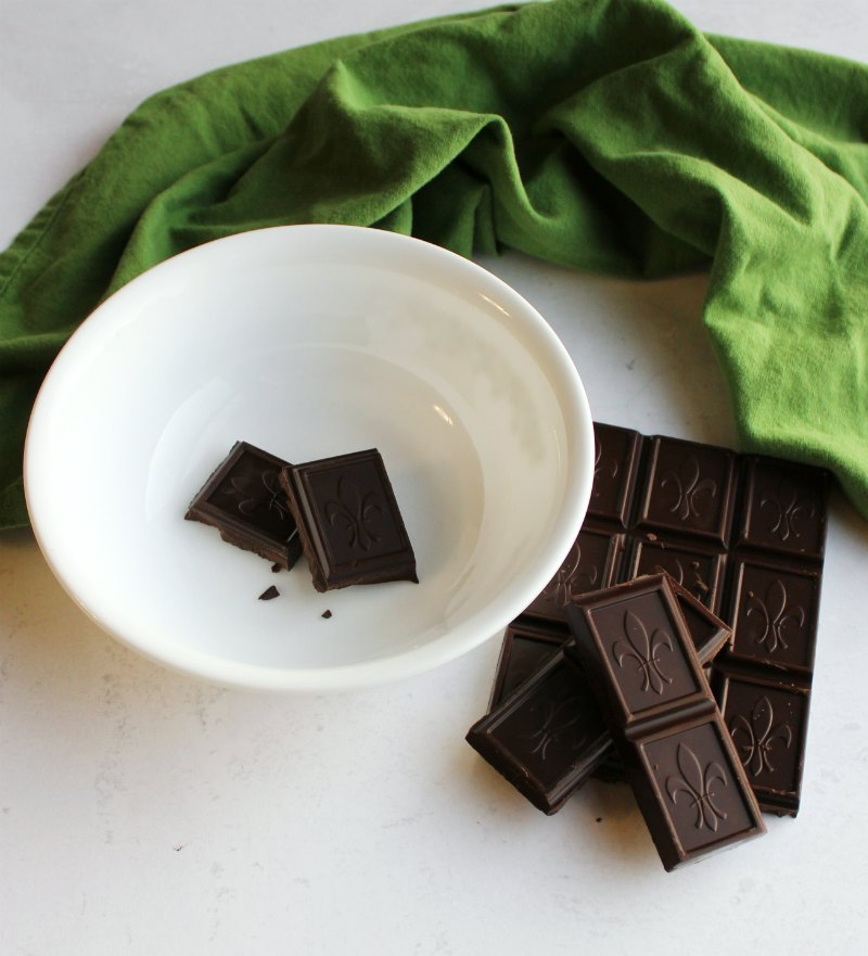 dark chocolate pieces by bowl ready to be made into ganache.