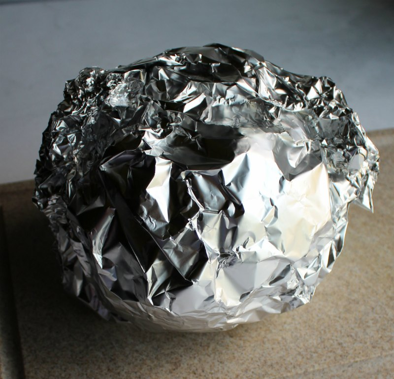foil ball with head of bacon wrapped cabbage inside