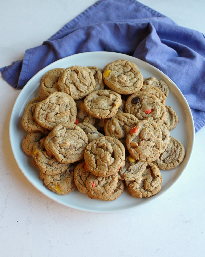 plate full of chewy triple peanut butter cookies.