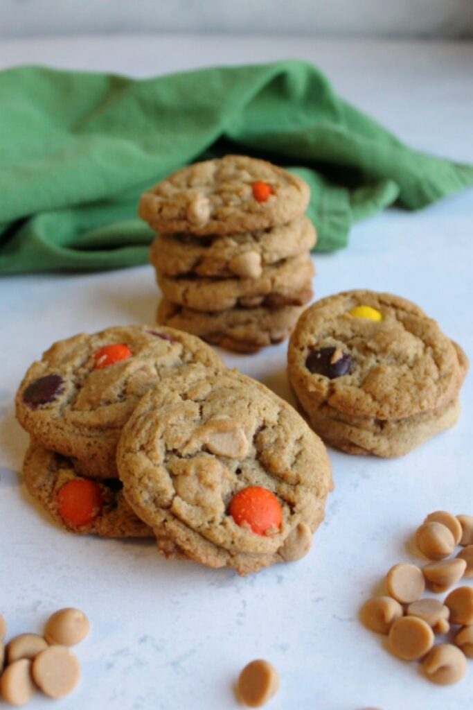 piles of triple peanut butter cookies with peanut butter chips and peanut butter candy.