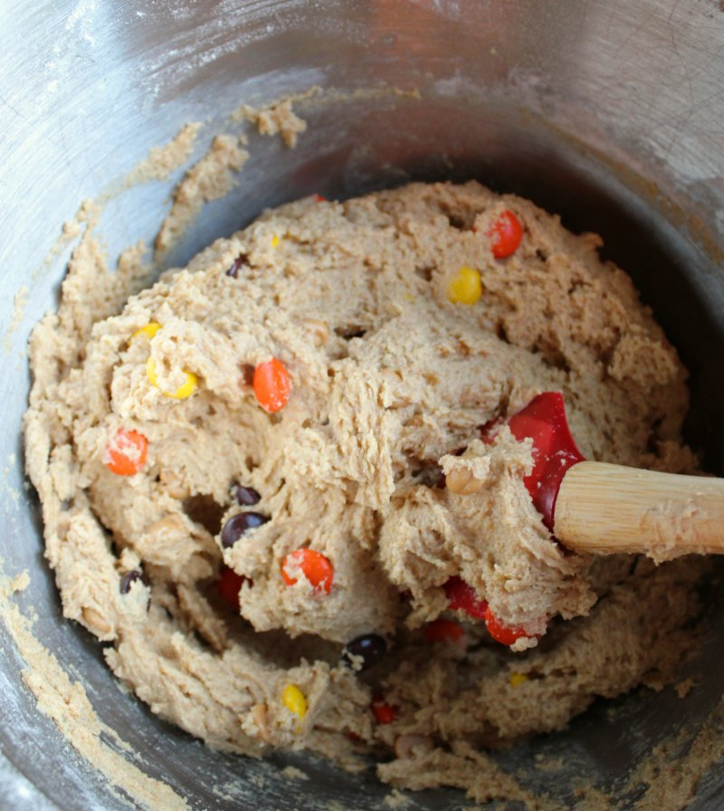 mixer bowl filled with triple peanut butter cookie dough, ready to bake.