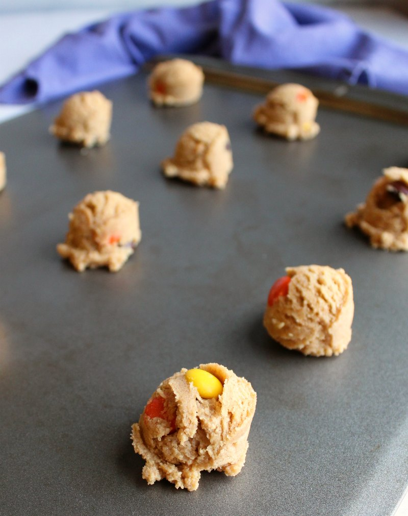 balls of triple peanut butter cookie dough on baking sheet ready to go in oven.