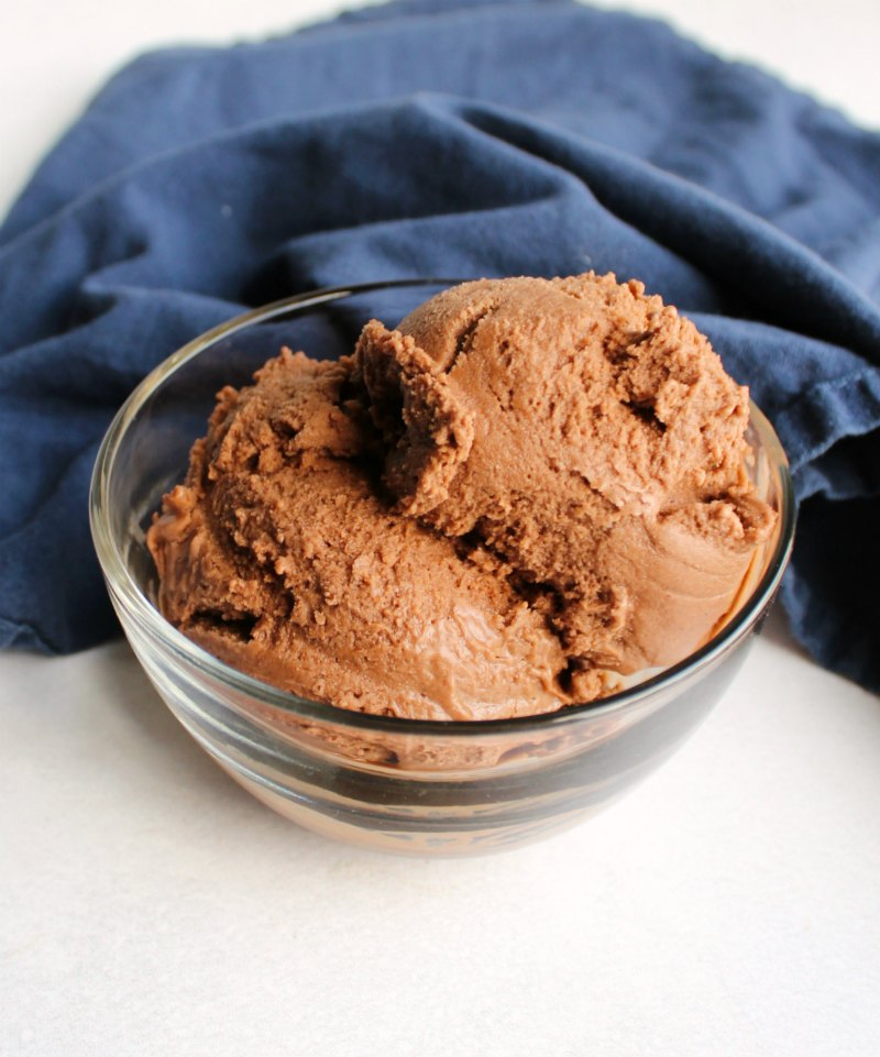 small glass bowl full of chocolate peanut butter nice cream.