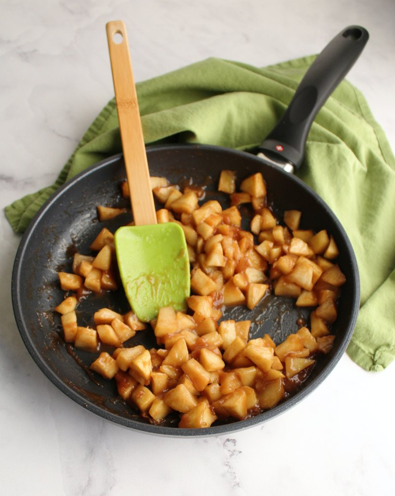 diced apples cooked in brown sugar and cinnamon for the caramel apple topping.