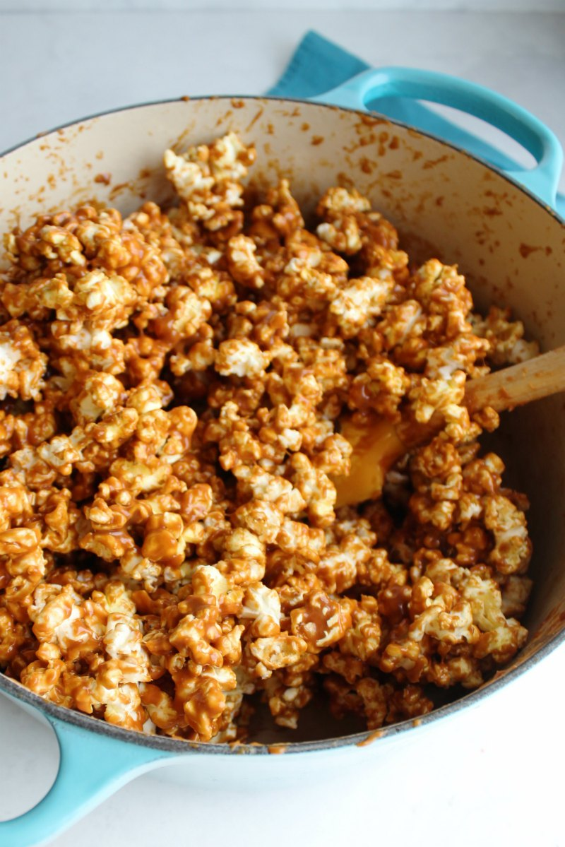 popcorn coated in apple flavored caramel ready to make popcorn balls
