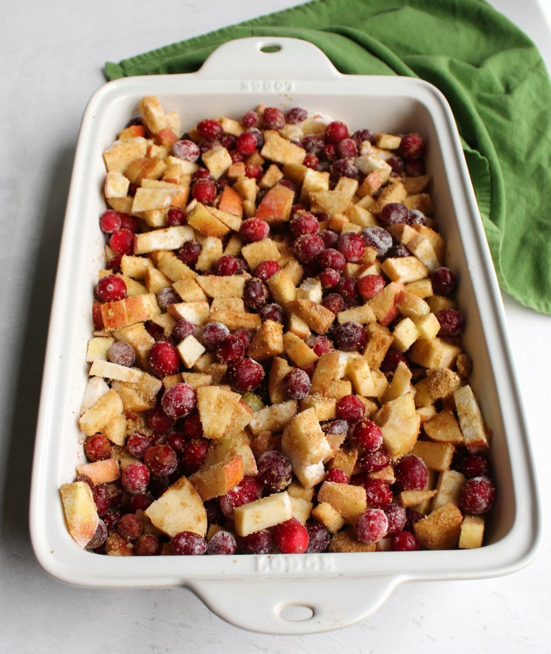 cranberries and apples tossed with brown sugar, cinnamon ready to bake into a crisp.