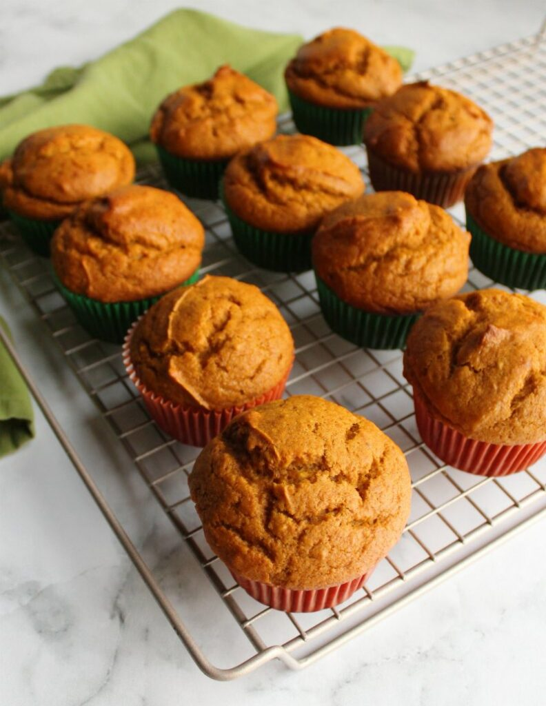 easy pumpkin cupcakes on cooling rack fresh from the oven.