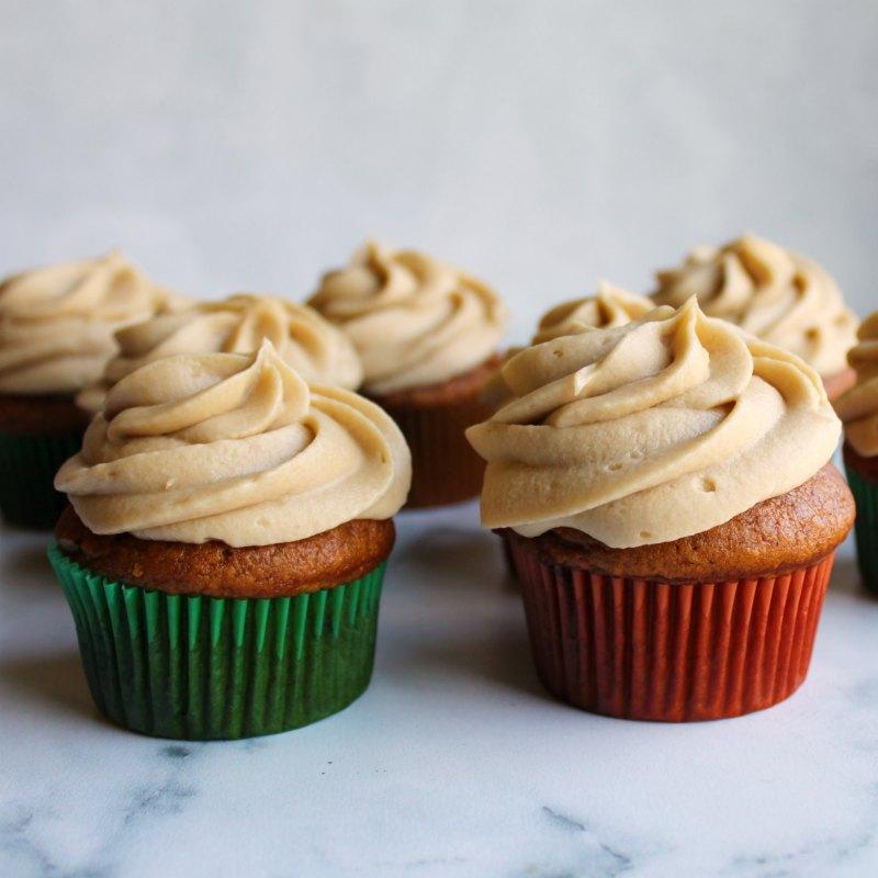 brown sugar german buttercream swirls on top of pumpkin cupcakes