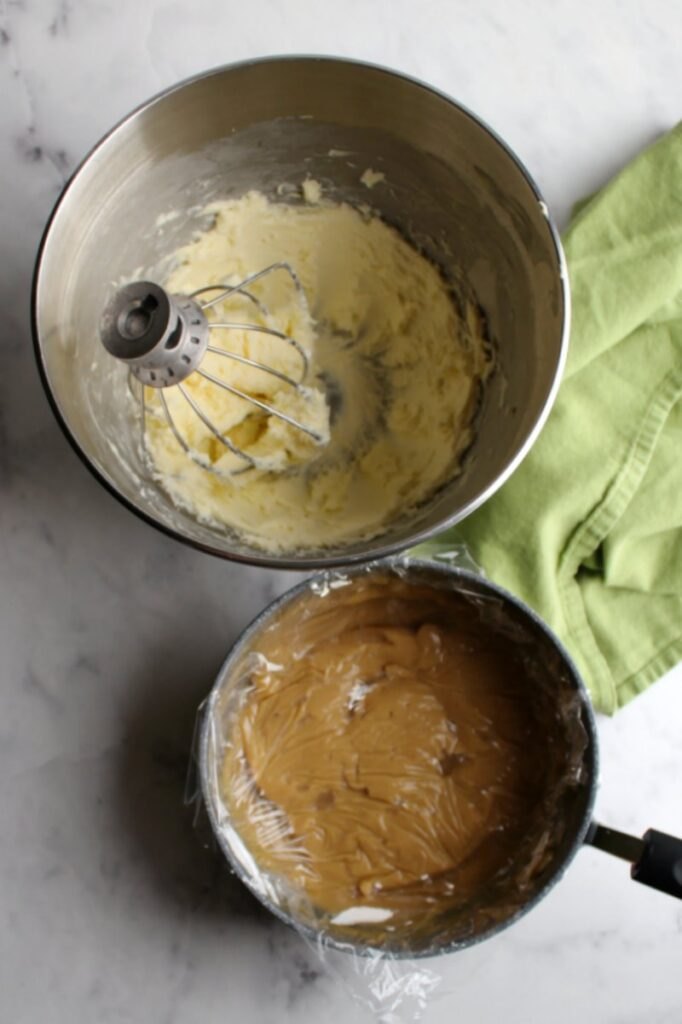 whipped butter in stand mixer bowl  with plastic wrap covered chilled brown sugar custard mixture nearby ready to be added
