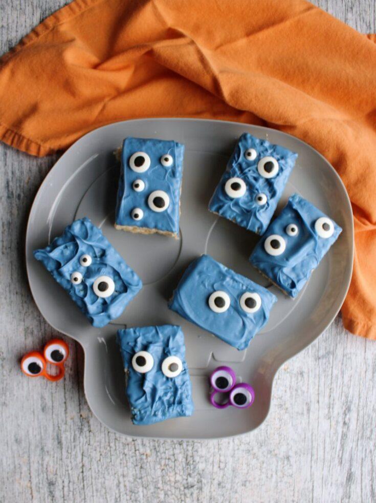 plate of blue monster rice krispie treats with eyeball rings,