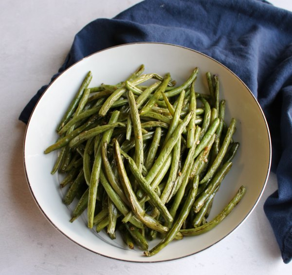 serving bowl filled with roasted green beans
