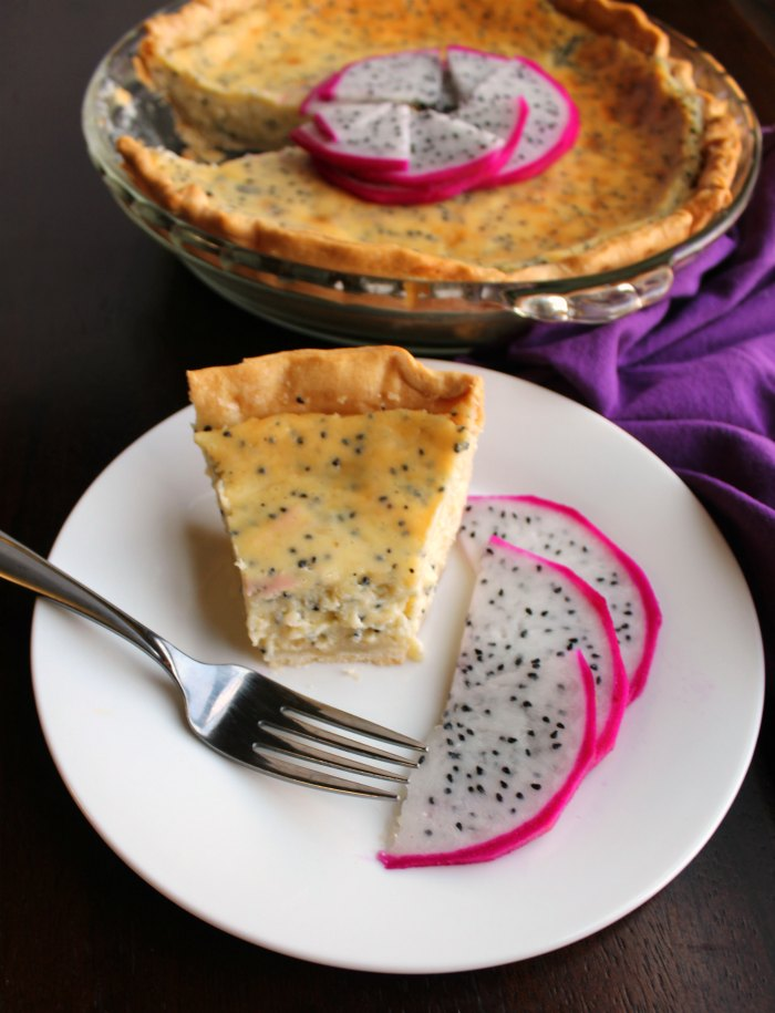 slice of creamy dragonfruit pie on plate with bite missing from tip