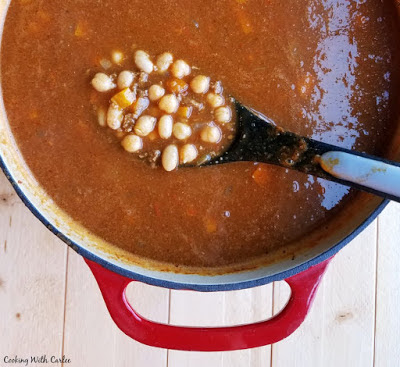 dutch oven full of pumpkin chili with white beans