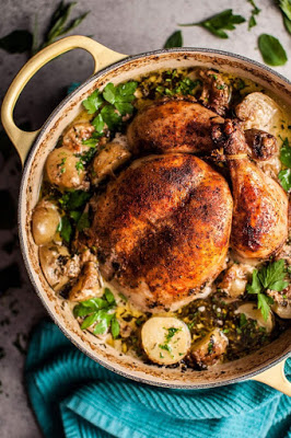 dutch oven filled with chicken, lemons etc.